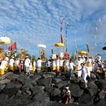 People celebrating a buddhist ceremony on a rock hill in Indonesia