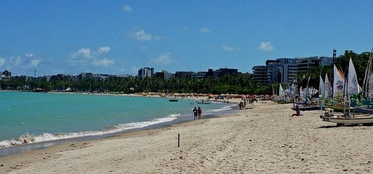 The white-sand beach and light blue waters of Maceio, Brazil