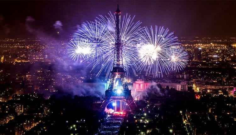 Fireworks light up the Eiffel Tower at night