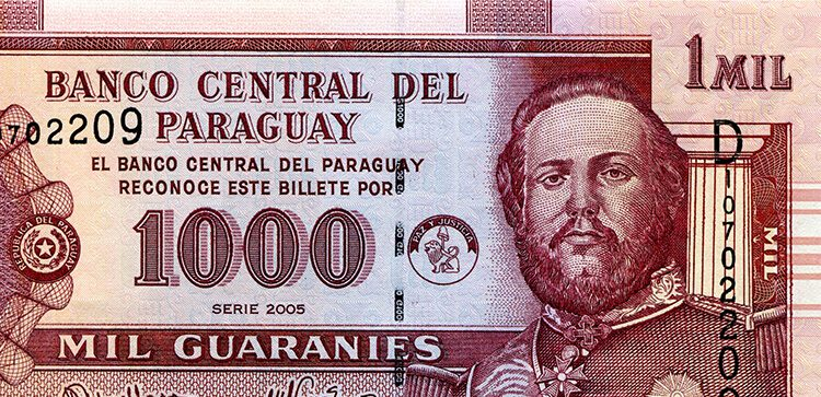 a close up of guaranies, paraguayan money