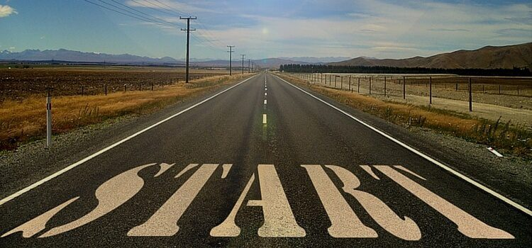 "A road in Paraguay with the word ""START"" spray-painted on the ground in white."