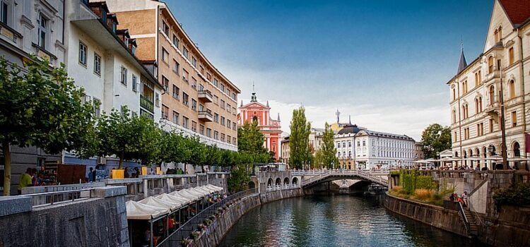 A view of the canal in Ljubljana, Slovenia between the buildings.
