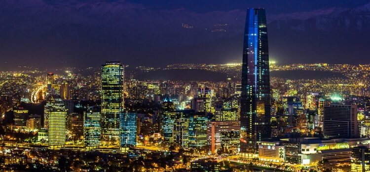 The bright lights and touring buildings of Santiago show a thriving Chile economy at work.