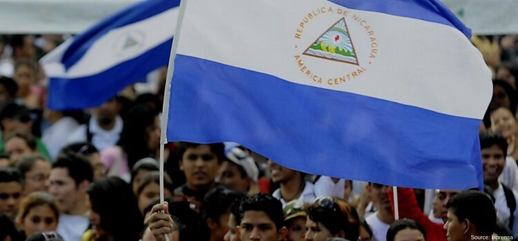 crowd of people holding Nicaragua flags