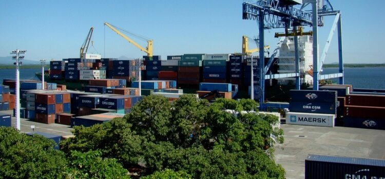Shipping containers being loaded at a port in Nicaragua
