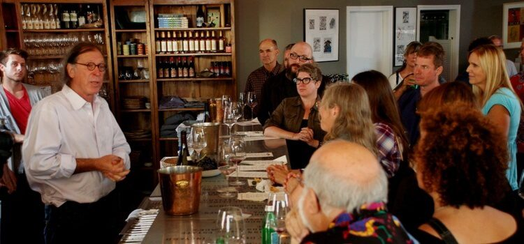 a sommelier giving a wine lecture at a tasting