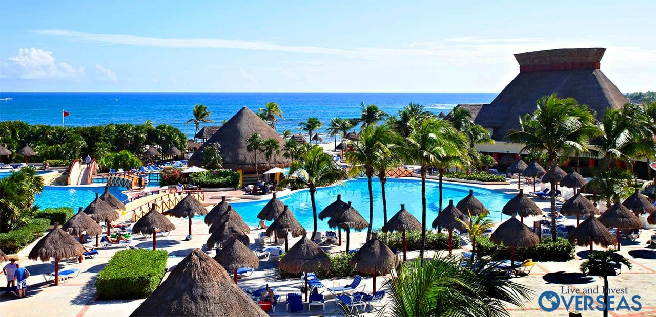 A Beach Resort With Cabanas And Large Pools In Mexico