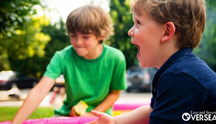 two boys playing outdoors