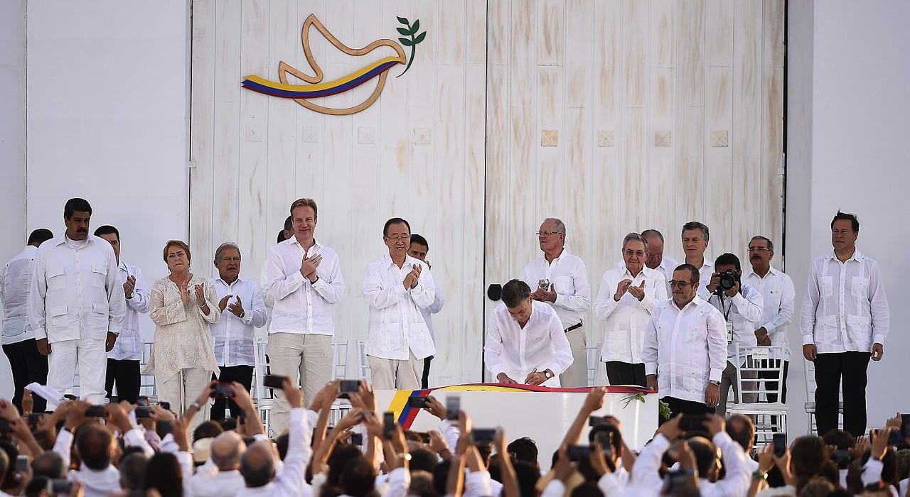 President Juan Manuel Santos Signing the peace treaty with FARC. This earned him the 2016 nobel prize.