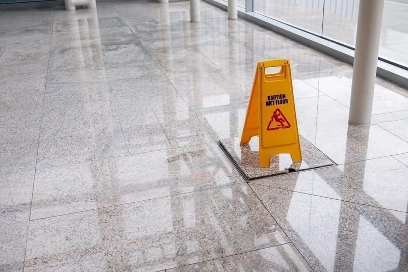 Wet floor sign on lobby.