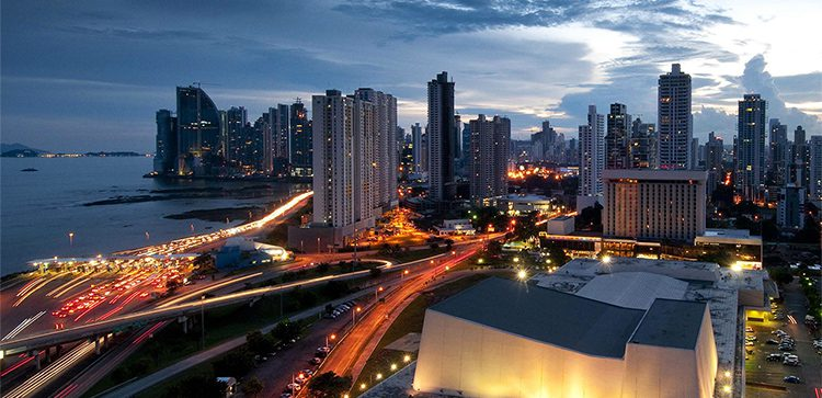Panama's toll road running along the coast lined with tall buildings
