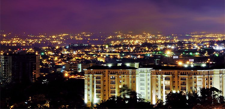 San Jose buildings lit up at night, infrastructure in costa rica