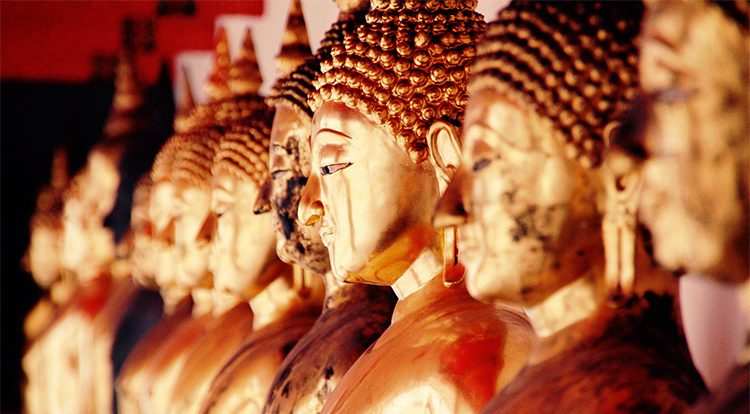 close up of buddhist statues in Thailnd