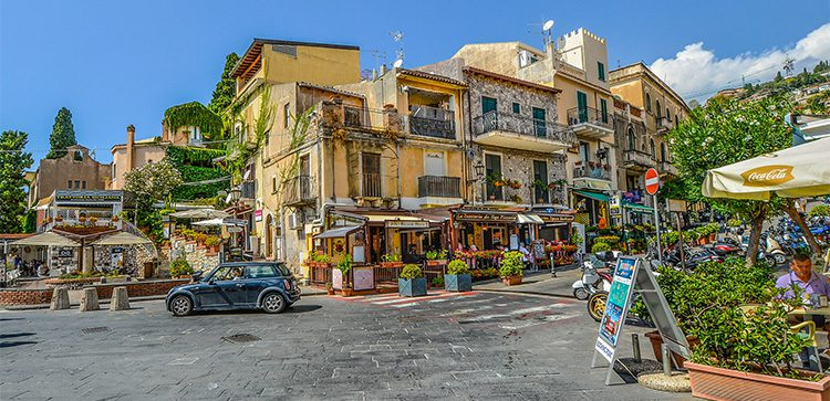 Quaint street with cafes and shops in Italy