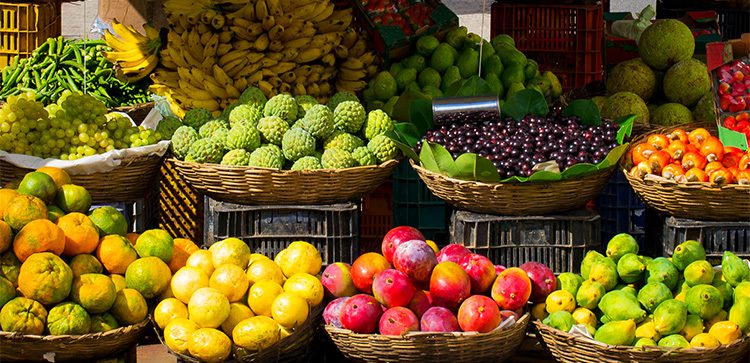 Fruits in baskets for sale at outdoor market