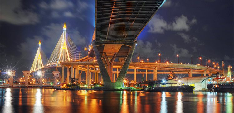 a view of the Bhumibol bridgelit up at night as taken from below