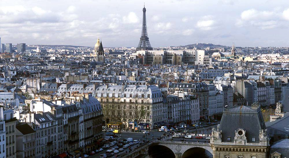 overview of Paris buildings with the Eifel tower in the background