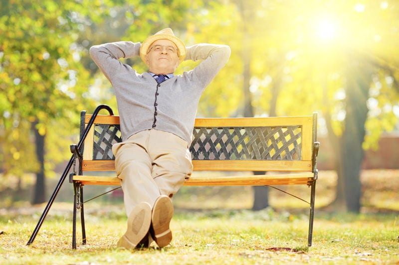 Retired man sitting on a bench