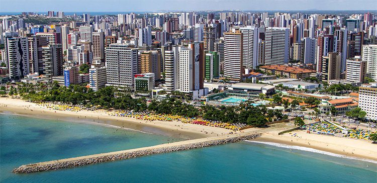 apartment and office buildings as far as the eye can see along the coastline of fortaleza brazil