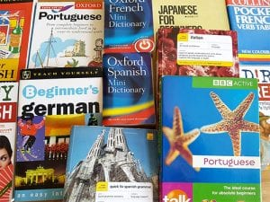 assorted language books laid out on a table
