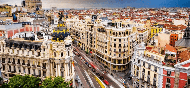 a busy street corner in madrid as seen from above