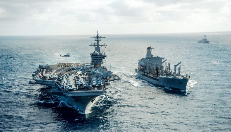 Military Ships And Helicopters At Sea