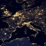 A map of Europe at night, with all the major regions lit up with lights.