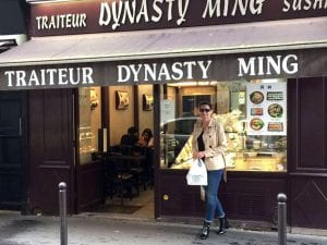 Kathleen picking up take-out from a local chinese restaurant in Paris