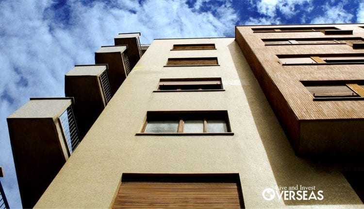An upward view of the front of an apartment building.