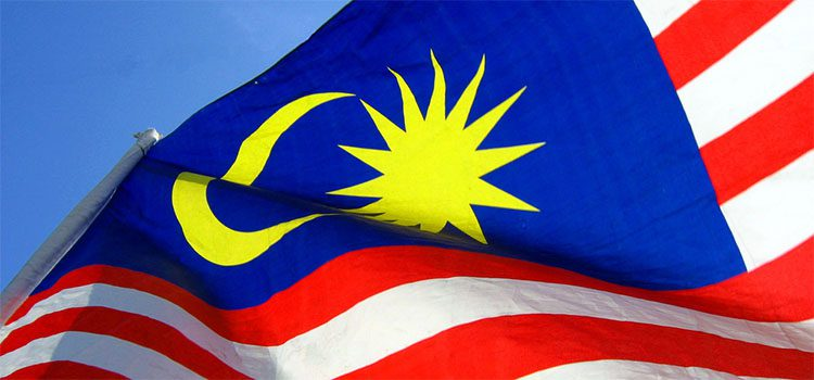 Malaysian red white and blue flag with yellow sun and moon