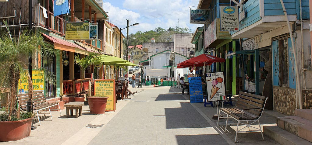 a street in San Ignacio Belize lined with shops and eateries