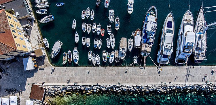 a marina with large and small boats as seen from above