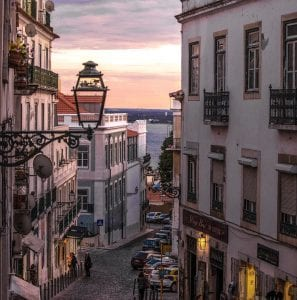 Cobblestone Street between apartment buildings in Lisbon
