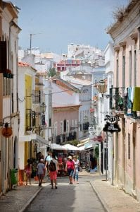 People walking down an alley in the Algarve