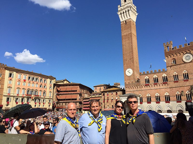 Kathleen and Lief standing with two friends among the crows at the Palio