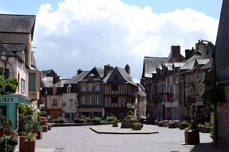Quaint town square with stone buildings in Morbihan