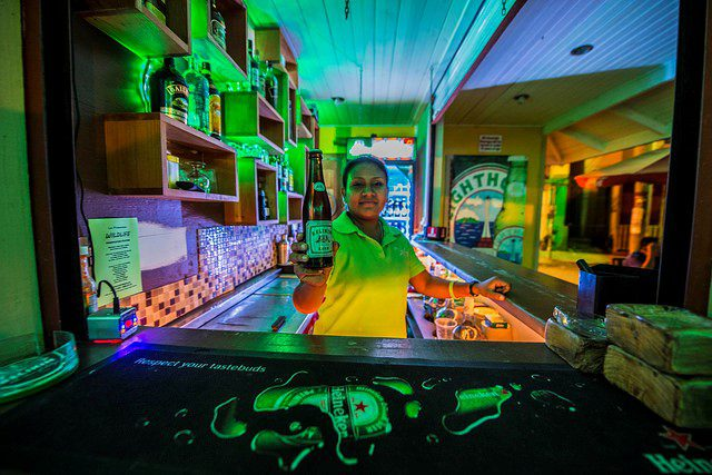 A woman selling beer at a local bar in San Ignacio