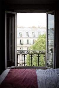 An open window in a Paris bedroom
