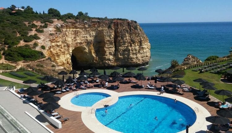 View of a figure eight shaped pool overlooking the Algarve coast