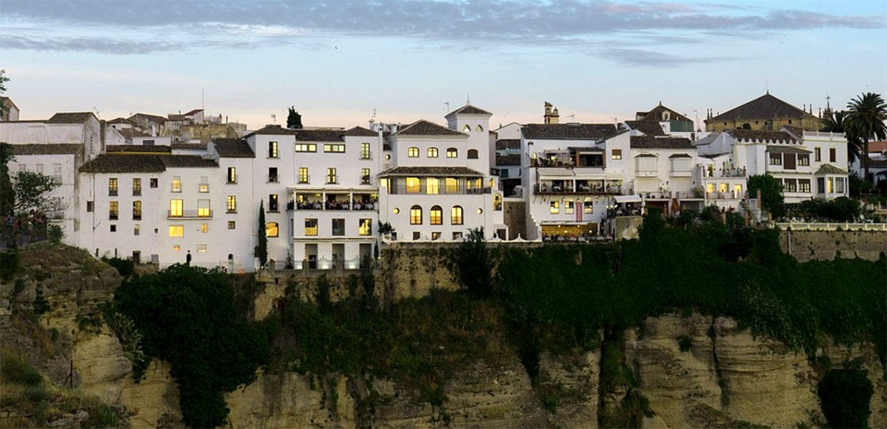 A row of houses on a cliff in spain