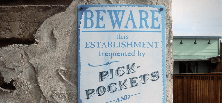 "A Sign saying ""Beware this establishment is frequented by pickpockets."""