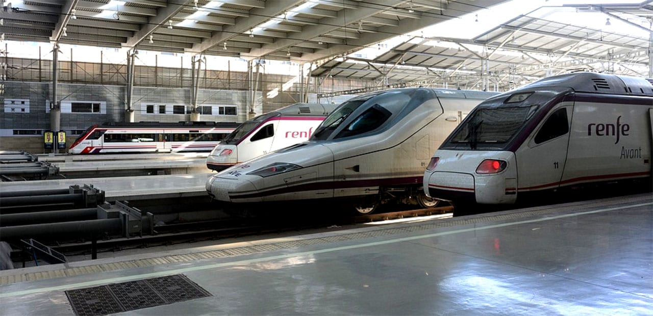 trains pulling into a train station in spain