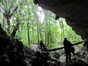 Tourists entering a cave dating back to the mayan Empire in Belize