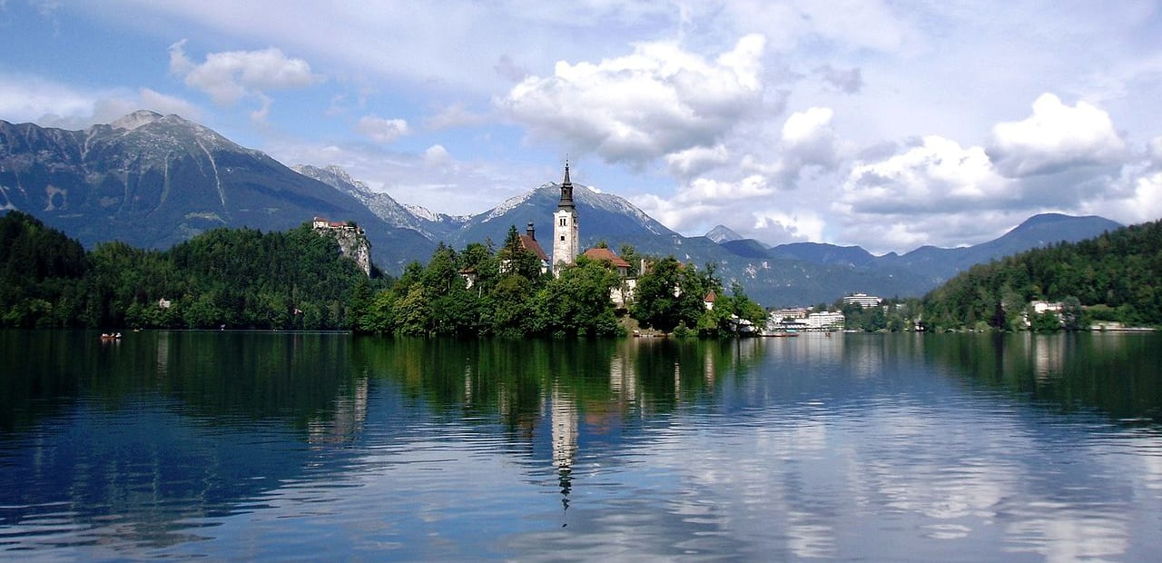 a church on an island in the middle of a lake