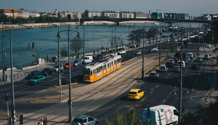 The yellow tram in Budapest runs next to the Danube River