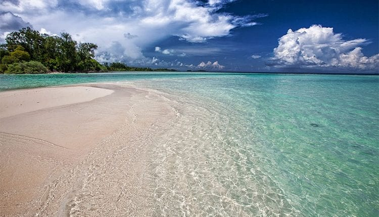 a white sand crystal clear water beach in Indonesia
