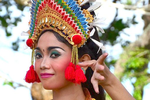 An indonesian woman dressed in local festive attire
