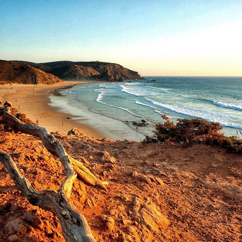 Sun shining on a cliff overlooking the beach