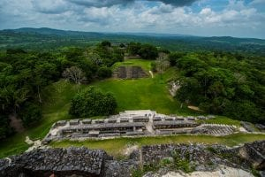 mayan ruins atop a green hill