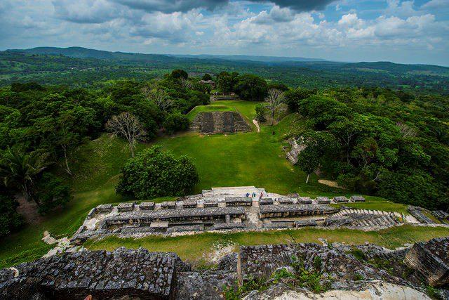 mayan ruins atop a green hill